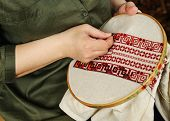 stock photo of stitches  - Hands women embroider on embroidery frame  - JPG