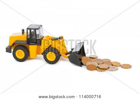 Toy loader and money coins isolated on white background