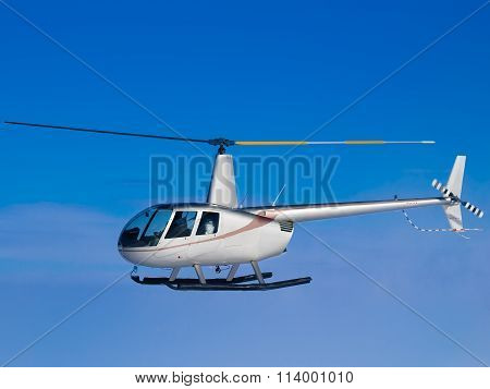Helicopter Flying In Blue Sky Side View