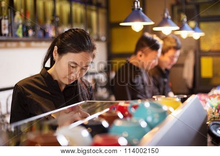 waitress serving in modern cafe