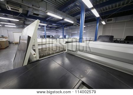 Large machines preparing samples for print in Polygraph complex