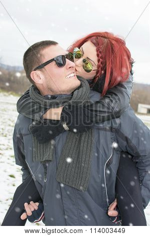 Girlfriend Kissing A Boyfriend On The Cheek
