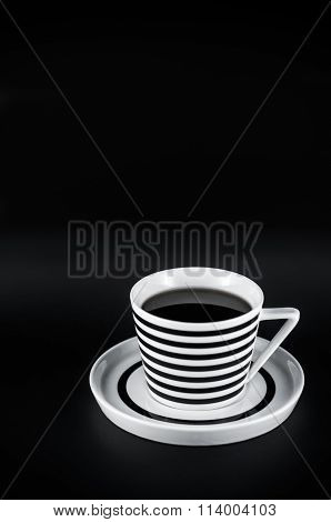 Hot Drink In Striped Cup On The Black Background. Black And White Minimalistic Composition