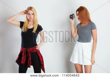 African Girl Photographing Blonde Woman