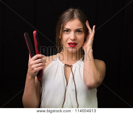Woman With A Flat Hair Iron