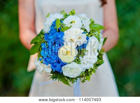 Bridal Bouquet Blue With White Flowers In The Bride's Hands