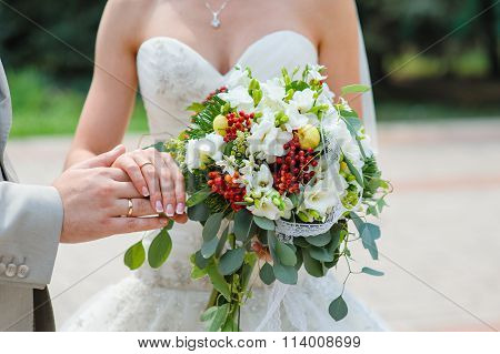 Hands With Rings Bride And Groom With Wedding Bouquet