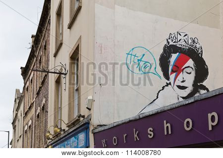 April 2014 - Bristol, United Kingdom: A Graffiti Of The Royal Queen With Red And Blue Lightning