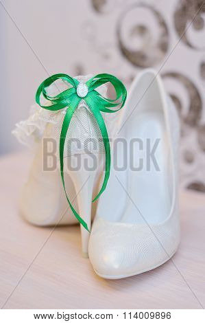 Elegant Bridal Shoes And A White Garter