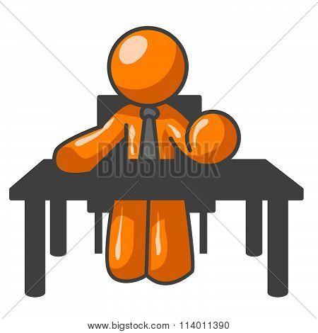 Orange Man At Table