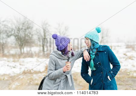 Two happy teenage girls in winter