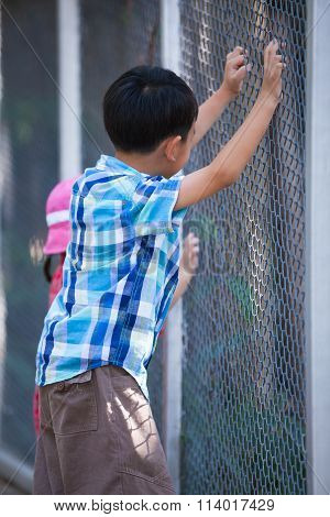 Children Catching Mesh Cage.