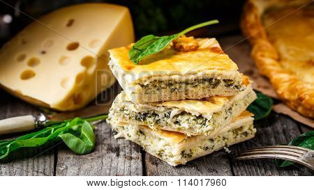 Homemade pie stuffed with cheese and spinach