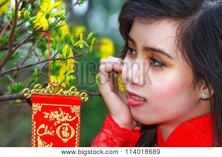 Teenager watching yellow apricot spring
