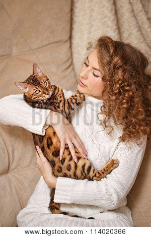 Girl Hugging Bengal Cat.