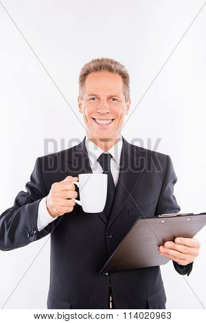 A Portrait Of A Smiling Business Who Has The Break With Cup Of Coffee
