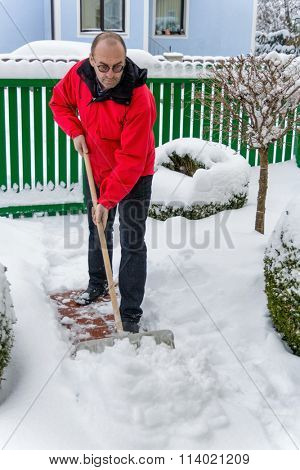shoveling snow at man