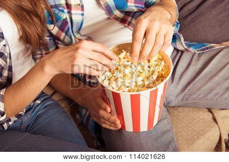 Young Woman And Man In Tartan Shirt Eating Popcorn
