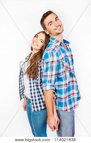 Portrait Of Young People Standing Back-toback Holding Hand In Hand