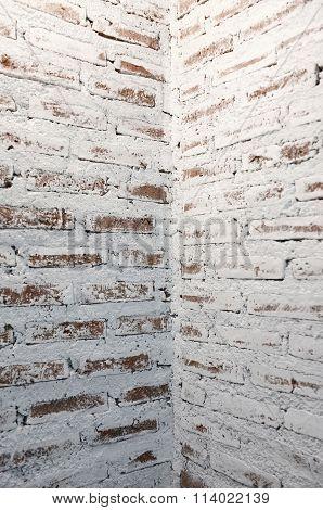 Corner of white brick wall