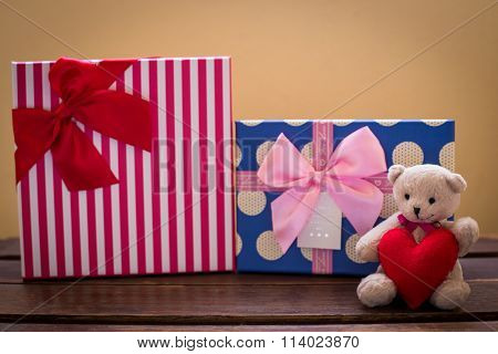 Teddy Bear With Pink Heart Decoration On Rose And Present Gift On Blue Background/ Valentines Day Ba
