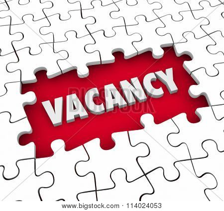 Vacancy word in 3d letters in a puzzle hole missing pieces to illustrate a need to fill an open job position or find a tenant for renting an apartment