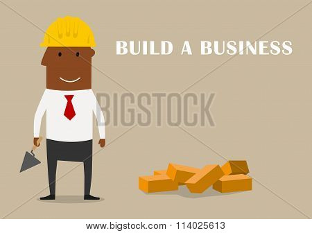 Happy businessman building a new business