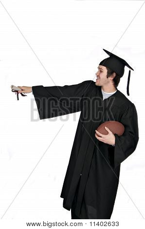 graduate pointing while holding football and diploma