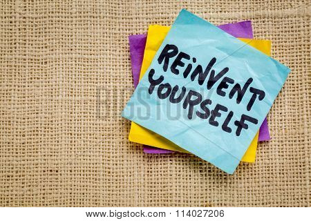 reinvent yourself advice - handwriting on a sticky note against burlap canvas