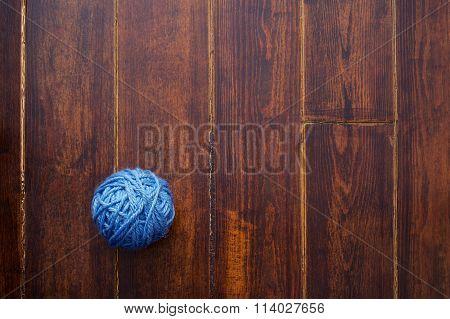 Blue Skein Over Wooden Background