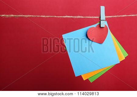 Blank Notes With Red Heart Against Red Background