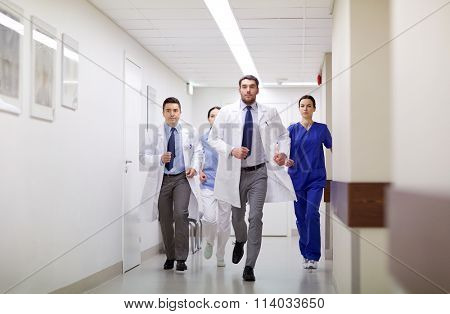 group of medics walking along hospital