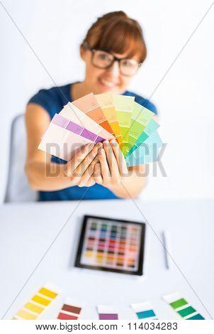 woman showing pantone color samples