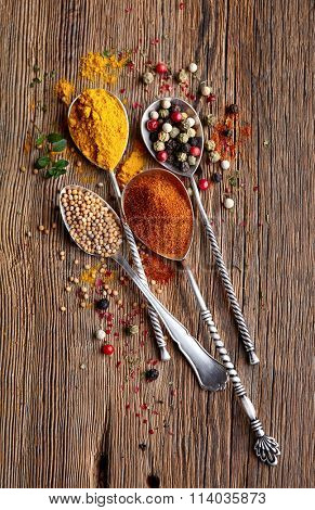 Mix spices on a wooden background