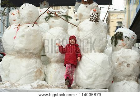 Group Of Snowmen And Little Girl