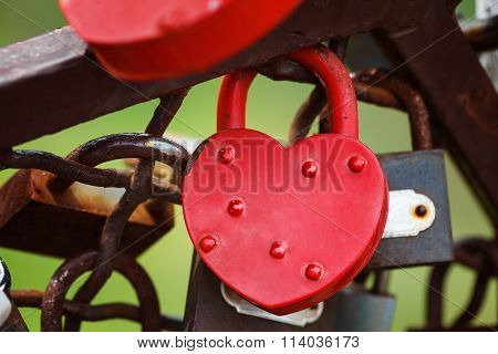Beautiful Red Heart-shaped Padlock Locked On Iron Chain.