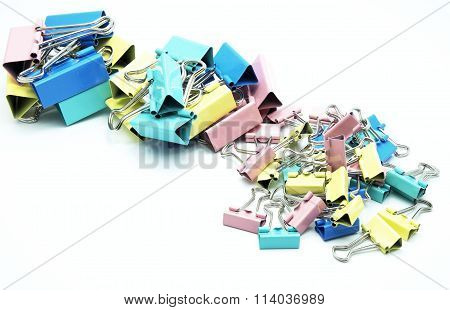 Various size and colorful paper clips. Isolated on white background