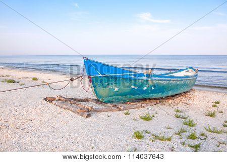 fishing boat on azure shore