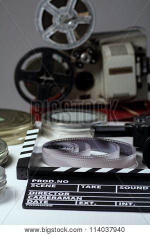 Old Retro Camera, Film Clapper, Rolls Of Film And A 35Mm Boxes For Films And Film Projector