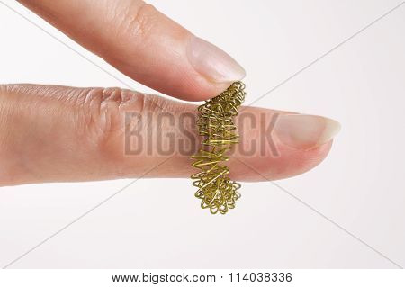 Fingers With Golden Massage Ring
