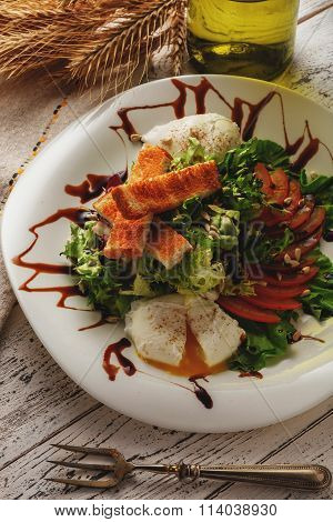 Salad Of Fresh Greens With Poached Egg And Croutons