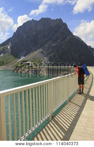 Man Looking Down To Artificial Lake Lunersee