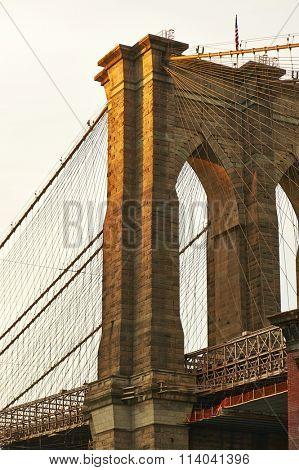 Close up of a pillar of the Brooklyn bridge at sunset, New York City, USA