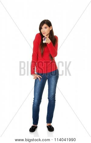 Beautiful woman pointing on you with big pencil.