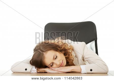 Businesswoman having a nap at her desk.