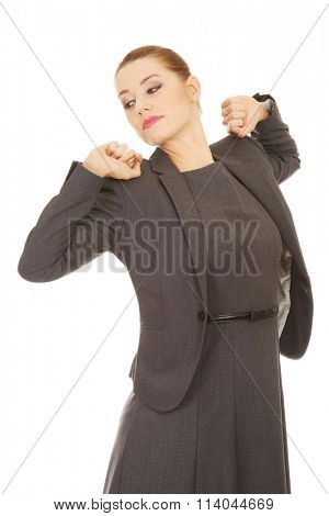 Businesswoman stretching her back.