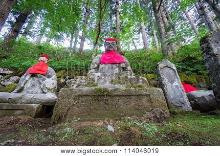 Closeup of moss covered statues of Jizo in Nikko