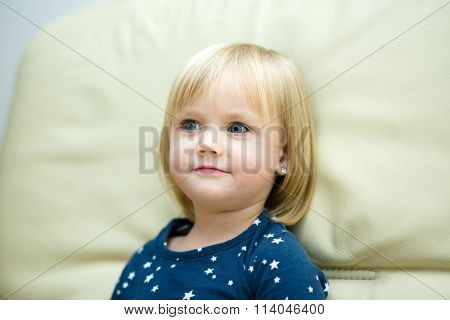 Little Girl Is Daydreaming
