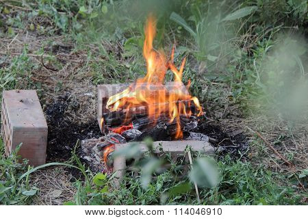Burning Fire Wood In A Brazier For Preparation Of Coals