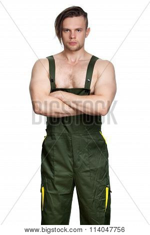 Strong Caucasian Man In Coverall With Folded Hands.
